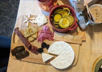Lobe II Bree homemade pickled onions, Shuby's mustard pickles, homemade hummus by Mario, and Saucisson Sec.